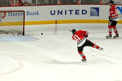 #88 Patrick Kane throwing a puck into the net during the pre-game skate sporting his Hossa sweater.