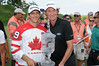 11 July 2010 Thornbury, Ontario: Wayne Gretzky and tournament winner, Peter Tomasulo during the trophy presentation after the final round of the Ford Wayne Gretzky Classic PGA Tour Nationwide golf tournament at the Georgian Bay Club in Thornbury, Ontario.  Peter Tomasulo won the tournament with a final round of -10 and a score of of -24 for the tournament.<br /> <br /> Mandatory Credit: Darren Eagles