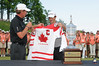 11 July 2010 Thornbury, Ontario: Wayne Gretzky presents tournament winner, Peter Tomasulo with a signed Canadian Olympic Hockey Team jersey after the final round of the Ford Wayne Gretzky Classic PGA Tour Nationwide golf tournament at the Georgian Bay Club in Thornbury, Ontario.  Peter Tomasulo won the tournament with a final round of -10 and a score of of -24 for the tournament.<br /> <br /> Mandatory Credit: Darren Eagles