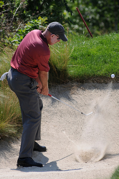 10 July 2010 Thornbury, Ontario: Frank Lickliter II with his bunker shot on the 12th hole during the third round of the Ford Wayne Gretzky Classic PGA Tour Nationwide golf tournament at the Georgian Bay Club in Thornbury, Ontario.  Peter Tomasulo won the tournament with a final round of -10 and a score of of -24 for the tournament.<br /> <br /> Mandatory Credit: Darren Eagles