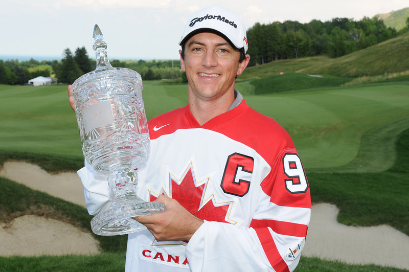 11 July 2010 Thornbury, Ontario: Tournament winner, Peter Tomasulo hoists the trophy after the final round of the Ford Wayne Gretzky Classic PGA Tour Nationwide golf tournament at the Georgian Bay Club in Thornbury, Ontario.  Peter Tomasulo won the tournament with a final round of -10 and a score of of -24 for the tournament.<br /> <br /> Mandatory Credit: Darren Eagles