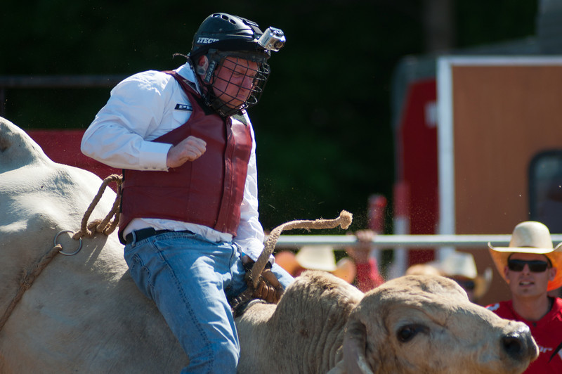 2011 June 26 - Meaford - The Ram Rodeo Tour rolled into the Meaford Fairgrounds this weekend.  The crowd was treated to a high energy event that showcased many talented rodeo riders. Captain Page from the Canadian Armed Forces rides a bull for the first time.  <br /> Photo Credit: Darren Eagles