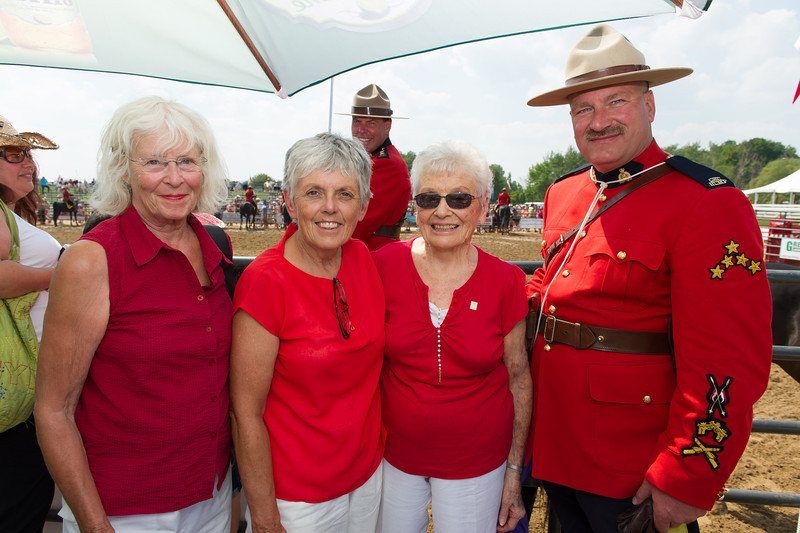 2012 Aug 24-26 - Cedar Run Horse Park - Thornbury -  The Cedar Run Horse Park was the location for the Rawhide Rodeo this past weekend.  The RCMP Musical Ride was on hand and performed an incredible show.  Beaver Valley Outreach founders (from left) Diana McGregor, Noreen Baron and Hazel South were on hand as the RCMP Musical Ride honoured guests.  <br /> Photo Credit: Darren Eagles