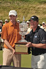 Roger Tambellini,  accepts the trophy from Wayne Gretzky himself at the 2009 Ford Wayne Gretzky Classic. Roger, who shot a final round 69, clinched the victory by 4 shots.  This win assured him his PGA Tour card for the 2010 season.  This official stop on the Nationwide PGA Tour was played at the Raven at Lora Bay and The Georgian Bay Club.