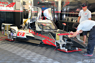 gull wing windows...pointed nose...half the weight and half the engine of the other cars in it's class. Twice the fuel mileage, and twice the tire wear....and the same speed!   This is the DELTAWING race car.