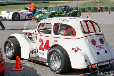 legend cars race on the 2 mile road course  #24 Carl Eckert