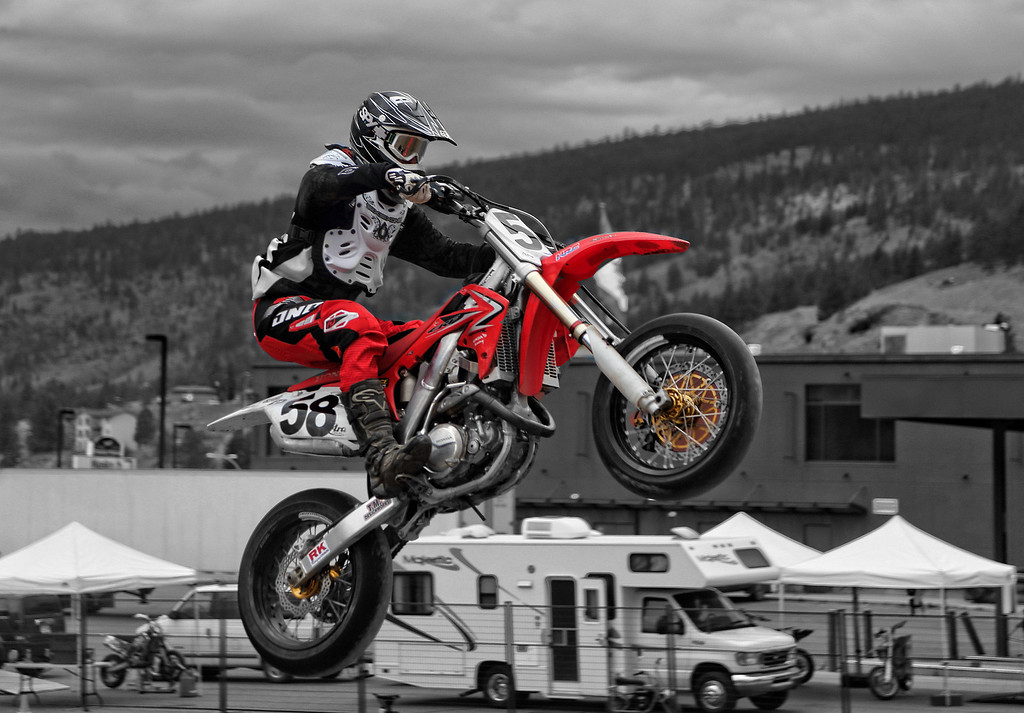 # 58 - Zoltan Gyulasi clears the triples at the Merritt Motorcycle weekend races.