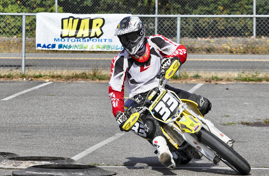 """# 33 - John Brown with a GoBo camera installed on the right handlebar. Checkout the video at <a href=""""http://s814.photobucket.com/albums/zz62/Knoakes/Supermoto%202011/?start=all"""">http://s814.photobucket.com/albums/zz62/Knoakes/Supermoto%202011/?start=all</a>"""