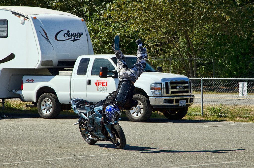 Steve does a backflip over his bike, onbviously a 'new' stunt....(grin) ....more in this series to come... no damage done to bike or rider.