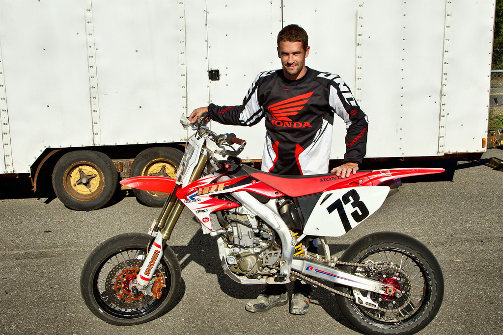 Aaron Grey - Supermoto rider, Bike # 73 with his bike... Thanks to Jason for letting  us use his Frankentrailer as a backdrop.