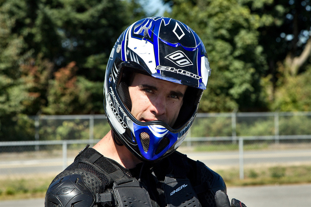 """Steven James Carey - Stunt Rider with the """"VanCity Stunters"""" drops in for a demonstration of his riding skills at the BC-Supermoto races at Tradex in Abbotsford on Sept 4th, 2011."""