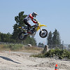 #33 - John Parker blasts his way over the triple jump in the dirt section - BC Supermoto Races - July 8th, 2012.