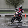 # 990, Devin Arthur was the first rider I shot on Sunday, April 7th. He led the first group of riders aroun d the wet and slippery track.