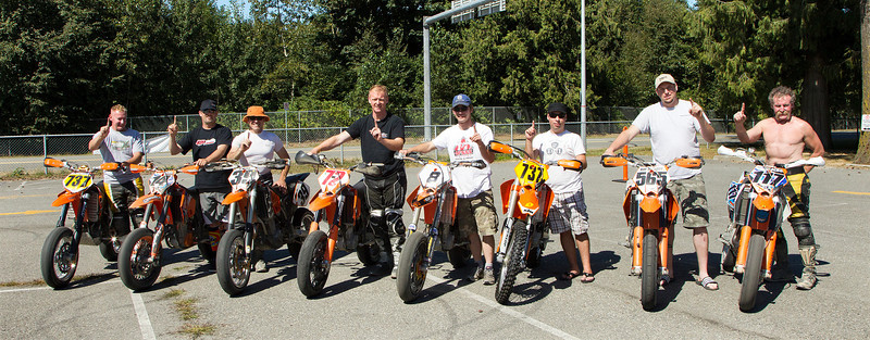 "The KTM Riders - the Orange Brigade, saying they are ""# 1""  during a break at the BC Supermoto races in Abbotsford on Sept 4th, 2011."