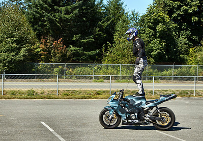 Steven James Carey - Stunt Rider - standing tall on his cycle.