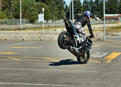 Steven James Carey - Stunt Rider - does a stoppie