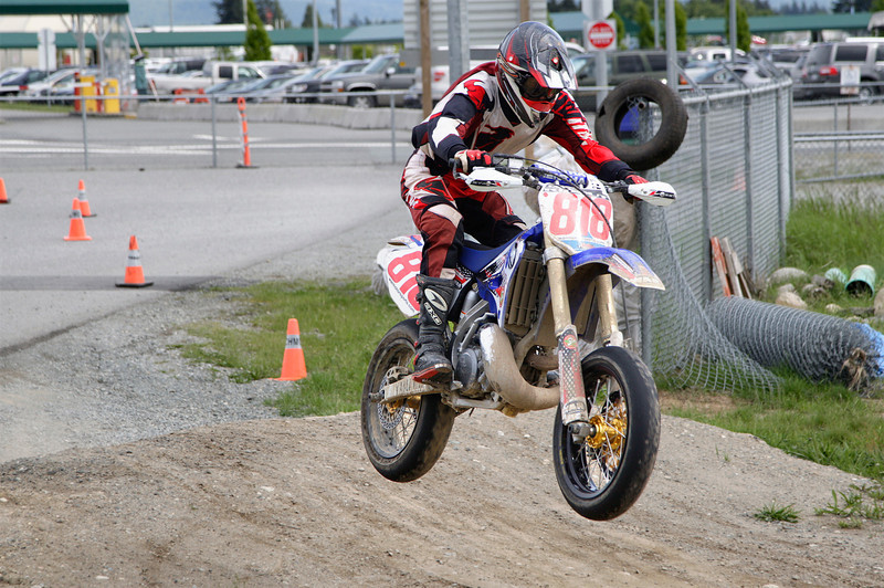 Greg rides the berm into the dirt section