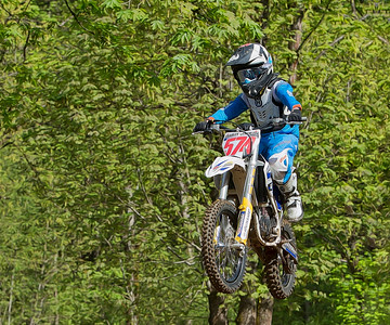 #574 - Charles Charlton  sails high during his Supermini Youth race