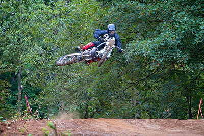"""Rhys Derksen whips by as he crosses """"Justin's Jump"""". Image modified in post."""