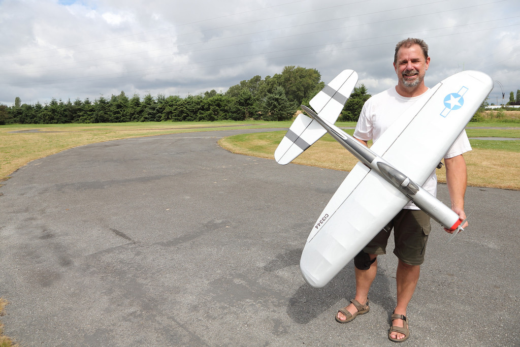 Glenn Little holds his electric powered Semi-scale Mustang Stunter.