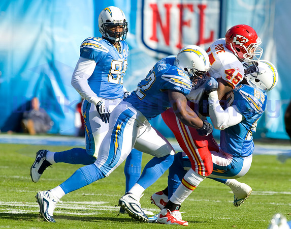 Nov 29, 2009; San Diego, CA USA; San Diego Chargers defense Larry English (52) and Sean Phillips (95) held the Chiefs to 14 points as the San Diego Chargers defeated the Kansas City Chiefs 43-14 at Qualcomm Stadium.