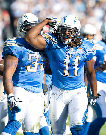 Nov 29, 2009; San Diego, CA USA; San Diego Chargers Legedu Naanee shows his muscle after stopping the Chiefs return specialist in his tracks.  The San Diego Chargers defeated the Kansas City Chiefs 43-14 at Qualcomm Stadium.