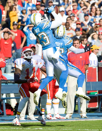 Nov 29, 2009; San Diego, CA USA; San Diego Chargers defensive backs Quentin Jammer (23) and Eric Weddle (32) go up to intercept a pass intended for Kansas City Chiefs Chris Chambers (11).  Jammer came down with the interception as the San Diego Chargers defeated the Kansas City Chiefs 43-14 at Qualcomm Stadium.