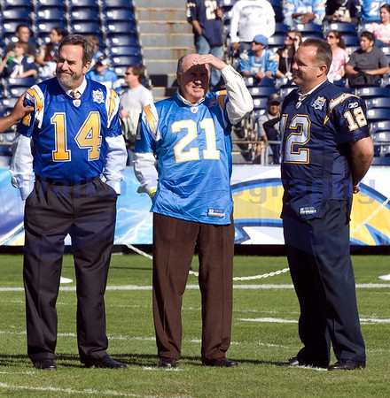 Nov 29, 2009; San Diego, CA USA; San Diego Chargers 50th Anniversary pre-game honored the 50 greatest Chargers of all time.  Pictured are the top 3 quarterbacks Dan Fouts (14), John Hadl (21) and Stan Humphries (12).  The San Diego Chargers defeated the Kansas City Chiefs 43-14 at Qualcomm Stadium.