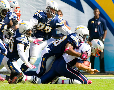Oct 24, 2010; San Diego, CA USA; San Diego Chargers outside linebacker Antwan Barnes (98) sacks New England Patriots quarterback Tom Brady (12) as the fall short of a fourth quarter comeback falling 23-20 to the New England Patriots at Qualcomm Stadium.