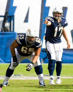 Oct 24, 2010; San Diego, CA USA; San Diego Chargers quarterback Phillip Rivers (17) leads the Chargers in a fourth quarter comback that fell just short as the New England Patriots defeated the San Diego Chargers 23-20 at Qualcomm Stadium.