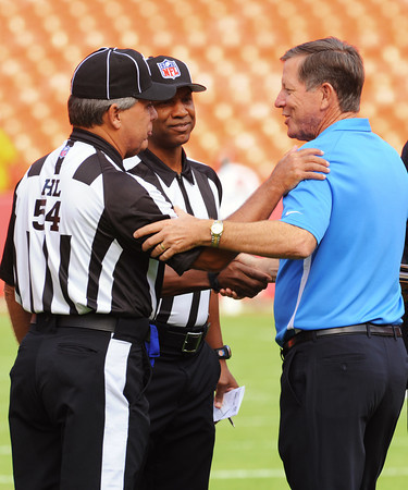 Sepember 30, 2012; Kansas City, Missouri, USA; San Diego Chargers Head Coach Norv Turner happily welcomes the return of the NFL Referees prior to the game beween the San San Diego Chargers and the Kansas City Chiefs.  The Chargers defeated the Chiefs 37-20 at Arrowhead Stadium.