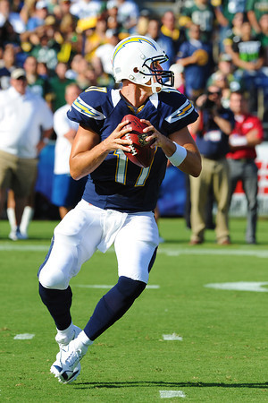 August 9, 2012; San Diego California, USA; Quarterback Phillip Rivers (17) directs a first quarter drive for a touchdown leading the Chargers to a 21-13 victoy over the Green Bay Packers at Qualcomm Stadium