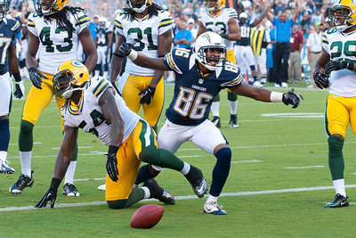 August 9, 2012; San Diego California, USA; Wide Reciever Vincent Brown (86) breaks several tackles in route to a 27 yard touchdown a pass completion from quarterback Jarrett Lee (16) leading the Chargers to a 21-13 victoy over the Green Bay Packers at Qualcomm Stadium