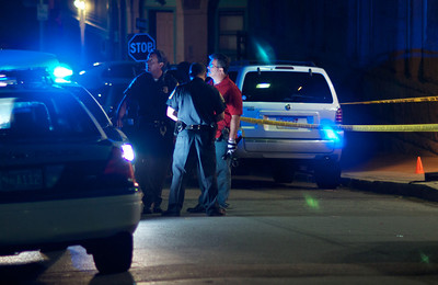090212, Boston, MA - Boston Police set up a crime scene in front of the old Joseph H. Barnes School on Marion Street in East Boston after a shooting occured around 9 p.m. Sunday night. Herald photo by Ryan Hutton