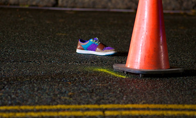 110812, Somerville, MA - A shoe sits in the middle of  Powder House Boulevard near its intersection with Packard Avenue after a pedestrian was struck by a vehicle. Herald photo by Ryan Hutton