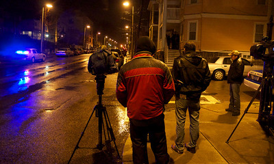 011113, Roxbury, MA - Reporters wait for a comment from police officials at the scene after the shooting of a youth at the intersection of Humboldt Avenue and Homestead Street. Herald photo by Ryan Hutton