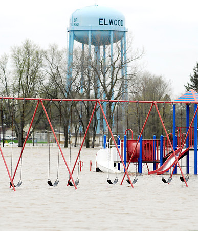 Flood waters of Big Duck Creek inundate the playground of Elwood Elementary School making it more like a water park.
