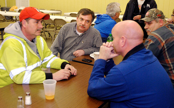 Elwood Mayor Ron Arnold talks with city workers as they take a break at the emergency shelter set up at the Cornerstone Assembly of God for evacuees and emergency workers to take a break and find food and shelter.