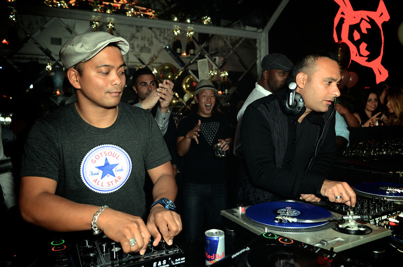 "Russell Peters spinning with Jojo Flores on Friday @ Maison Mercer following the release of his film ""Breakaway"" @ The Toronto International Film Festival"