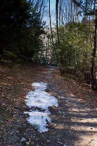 Snow on the path. Early April in Black Rock State Park, Watertown, CT