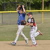 STAN HUDY - SHUDY@DIGITALFIRSTMEDIA.COM<br /> Saratoga-Wilton base runner James England takes off his helmet after being tagged out by Spring Renegades Cal RIpken 11U pitcher Alex Halwick during a rundown between second and third base during the Eastern NY State tournament at Indian Meadows Park.