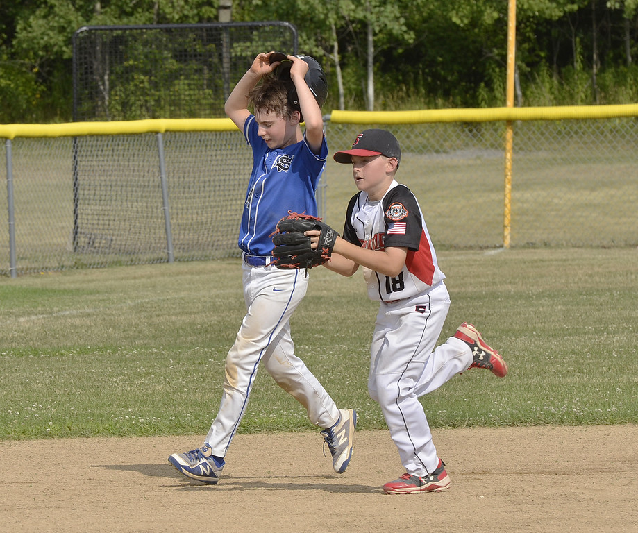 . STAN HUDY - SHUDY@DIGITALFIRSTMEDIA.COMSaratoga-Wilton base runner James England takes off his helmet after being tagged out by Spring Renegades Cal RIpken 11U pitcher Alex Halwick during a rundown between second and third base during the Eastern NY State tournament at Indian Meadows Park.
