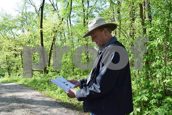 Darrell Shambaugh of Somonauk reads about the species of bird he spotted in Sannauk Forest Preserve in Somonauk during the annual statewide Spring Bird Count on May 6. Shambaugh, the SBC organizer and compiler for DeKalb County, said birding can be a fun social event if you bring along a friend, a pair of binoculars and a book.