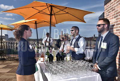 Kate Otis from DeCrescente Distributing Co., left, with featured bartenders Eli Rabinowitz and Ryan Duff from sponsor Pioneer Wealth Management.