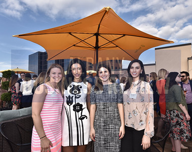 Alicia Novak, left, and Shannon Saiid from Accent Commercial Furniture, Madeleine Petraglia from the Ballston Spa Central School District and Fatin Haddad from Phillips Lytle.