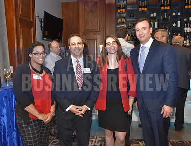Kristian Hackey from National Business Technologies, Peter Lauricella from Wilson Elser, Jessica Lewis from National Business Technologies and Tim McGuire from the Picotte Companies.