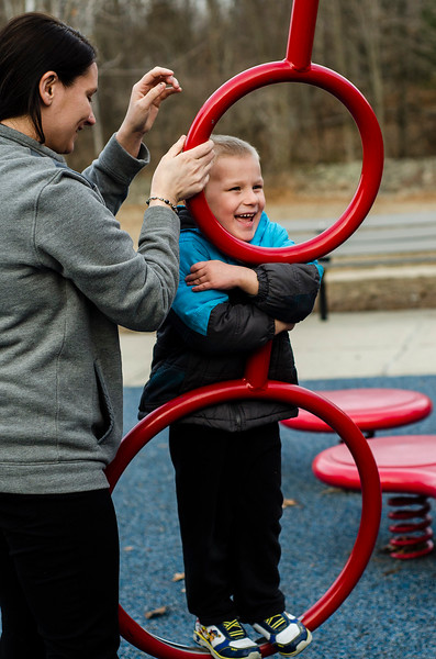 Ryker Bray, 4, gets a spin from mom Beth Fogle on the playground at Coolidge Park in Fitchburg during the spring-like weather on Tuesday, February 28, 2017. SENTINEL & ENTERPRISE / Ashley Green