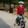 Ashton Lavoie, 2, rides his bicycle around the playground at Coolidge Park in Fitchburg during the spring-like weather on Tuesday, February 28, 2017. SENTINEL & ENTERPRISE / Ashley Green