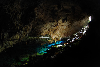 Using only natural sunlight, a five-minute time laps image captures the beauty of this Dominican Cave entrance and blue water pool.