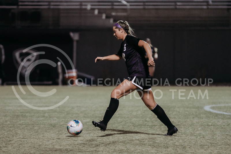 Sophomore defender Kenzie Applegate moves the ball up the field during the March 6, 2021 game against KU. (Sophie Osborn | Collegian Media Group)